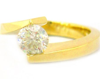 Round diamond engagement ring tension set 0.75ctw 14k yellow gold