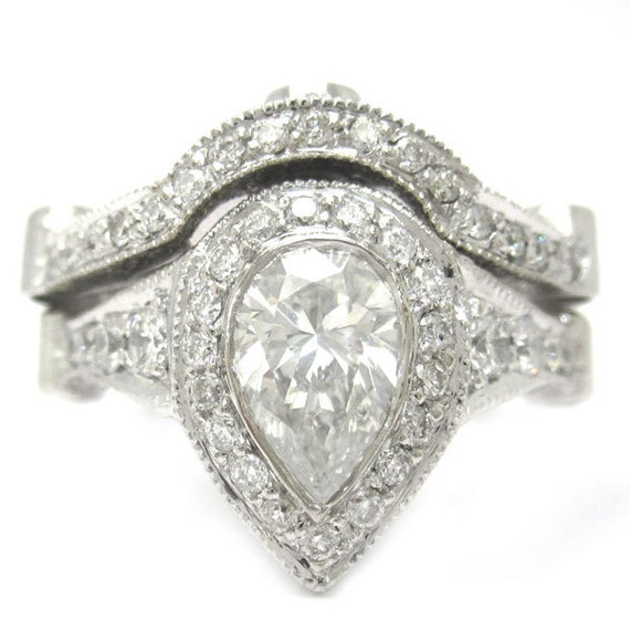 Pear shape diamond bezel set engagement ring and band 2 35ctw