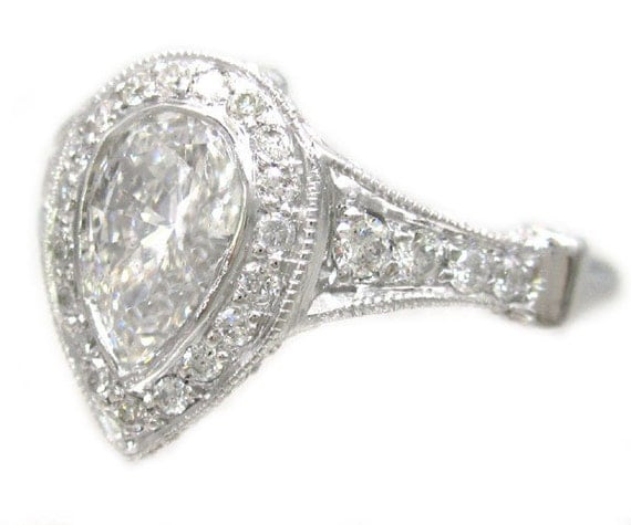 14k white gold pear shape diamond bezel set engagement ring