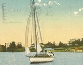 Yachting near KENORA Lake of the Woods Ontario 1923 slogan cancel on vintage postcard - charming sailboat