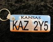 Ready-to-Ship - Supernatural TV series Metallicar Impala Kansas license plate keychain