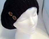 Black hand knitted beret with brown buttons