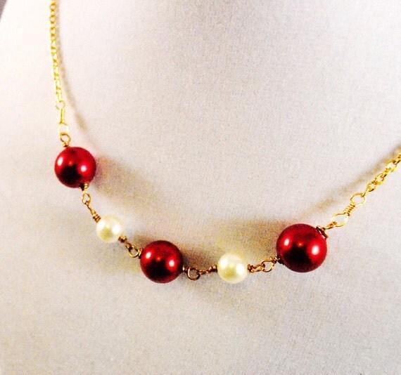 Terra Branford IV - Crimson and Cream Swarovski pearls on Gold