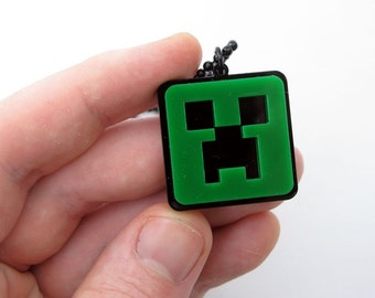 Creepy green pixels monster necklace