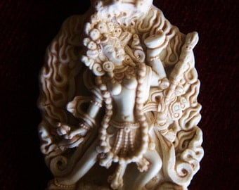 one pendant KALI 1-1/2 inches and a 3 inch statue from our origanal sculture in a ivory finish goddess hindu