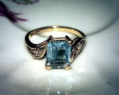 Art deco 14 kt yellow gold ring with emerald cut clear aquamarine and 2 diamonds.