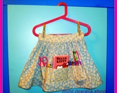 s a l e. sugarplum faerie apron for girls with art supplies.