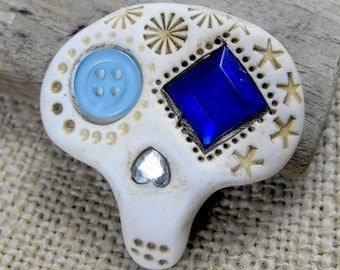 Mini sugar skull brooch with sweet blue eyes