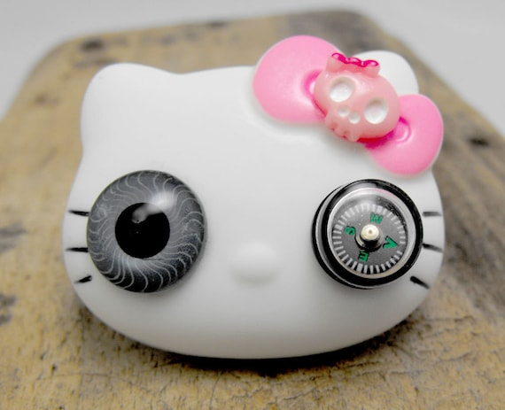 Steampunk Hello Kitty brooch with a compass eye