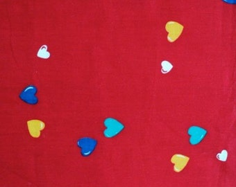 Yellow, Blue, White and Green Hearts on a Red Background Fabric - 1-1/2 yards