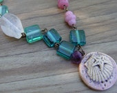 Colors of the Ocean in Crystal Quartz, Glass and Brass Necklace