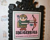 Vintage iron sagittarius zodiac trivet