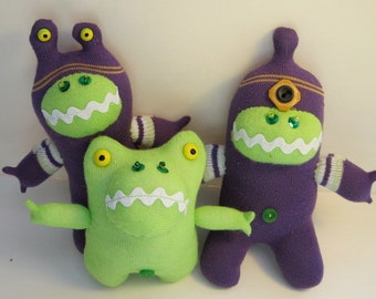 The ALIENS NEXT DOOR reclaimed sock family of 3 in purple and green