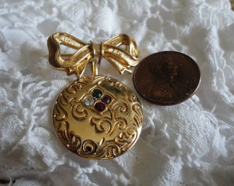 Gold Tone Bow and Birthstone Vintage Brooch from Avon