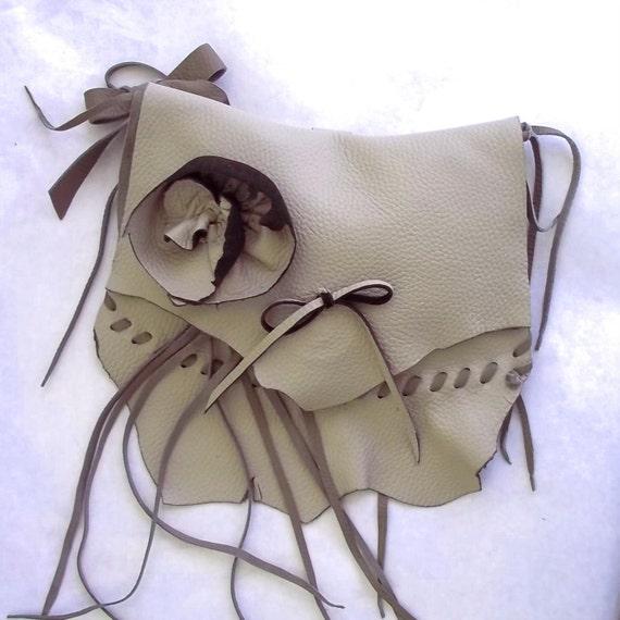 wristlet, clutch, handbag, belt bag in leather with flower rose design. Reserved for M.