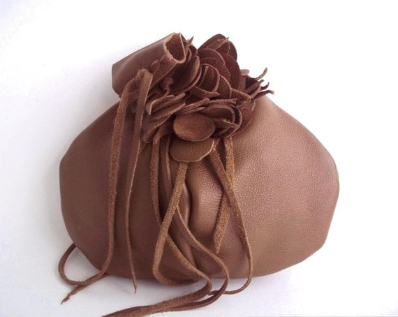 leather wristlet in light brown with detachable flower,hat pin or brooch by Tuscada. Ready to ship.