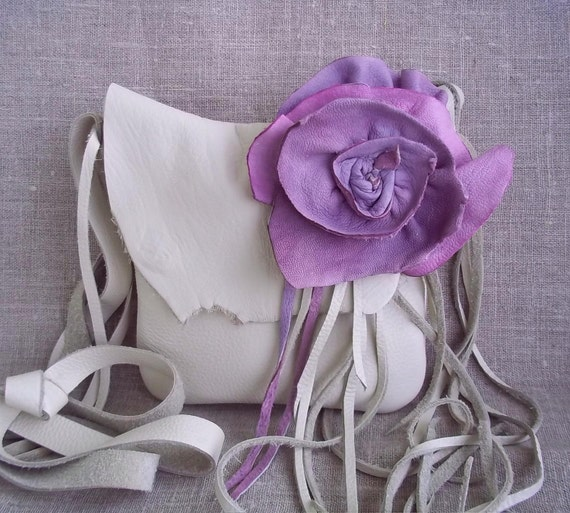 cream white leather handbag messenger with a two toned, purple, lavender, and  pink rose flower pin