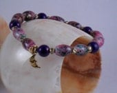 Handmade stretchy Purple bracelet with moon charm