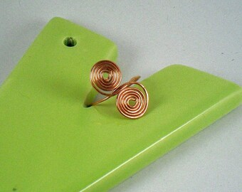 Handforged and textured shiny pure copper swirled ring