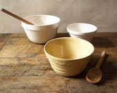 collection of three mixing bowls