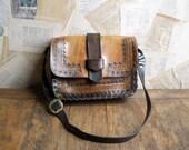 vintage brown tooled leather saddle bag