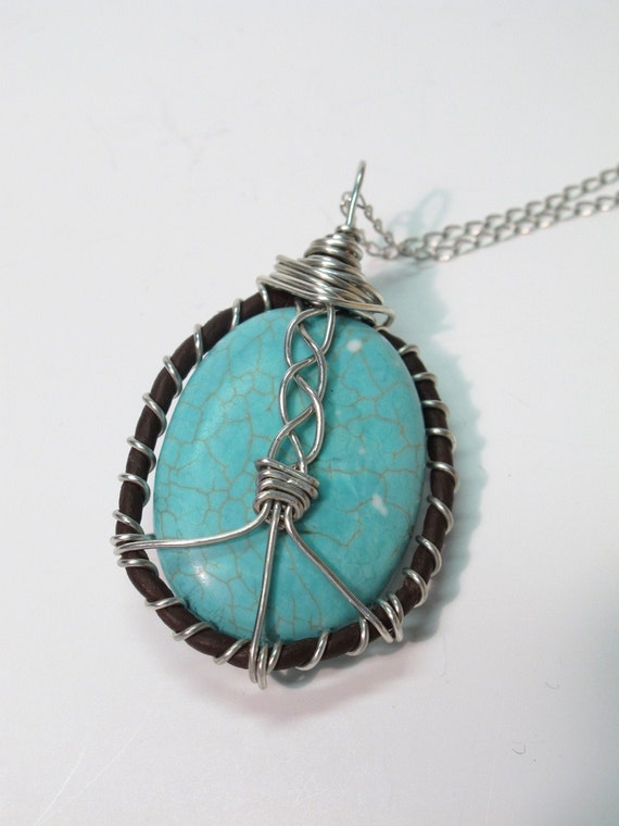 WORLD PEACE. A Turquoise and Leather Wire Sculpture Necklace.