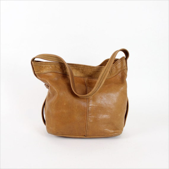 saddle leather slouchy hobo 1970s / honey brown leather
