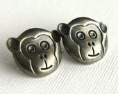 Vintage Plastic Monkey Head Buttons . Silver Tone . Set of 2