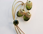 DeLizza & Elster for Sarah Coventry - A Touch of Elegance - Peridot Green and Gold Brooch
