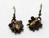 Little Bee resin dangle earrings Brozne
