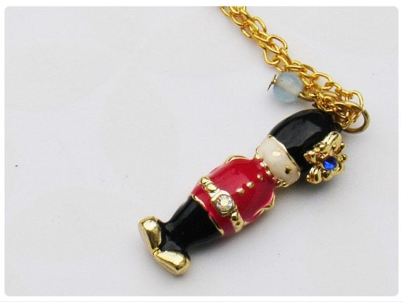 The Queen's Guard - enamel charm in gold tone necklace