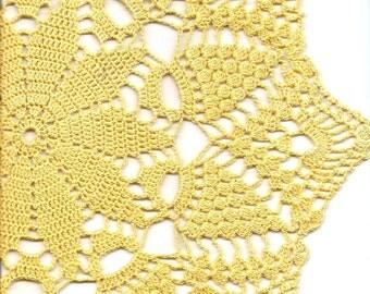 Large yellow crochet doily