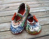 Mary Jane style slippers with flowers in hues of blues, greens, pumpkin, brown, white