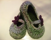 Mary Jane style slippers with flower in olive tree, hues of lavender, blue, and green, pale yellow