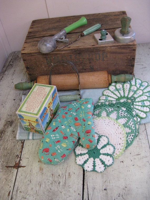 green kitchen utensil collection crocheted potholders recipe box dish towel rolling pin ice cream scoop