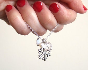 Snow white Inspired Snow flake pendant necklace with crystals and a fresh water pearl on a silver plated chain