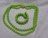 Vintage Richelieu chartreuse double strand cabachon clasp necklace and double coil bracelet