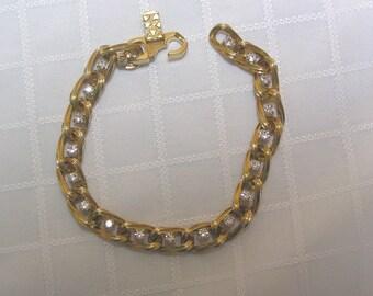 Vintage designer style clear sparkling rhinestones and gold link bracelet
