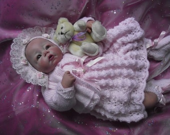 Knitting pattern for 16 inch-20 inch dolls or 0-3 month baby