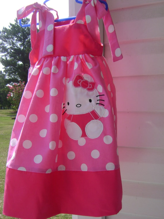 Dress with the kitty sizes 6 months up to size 10