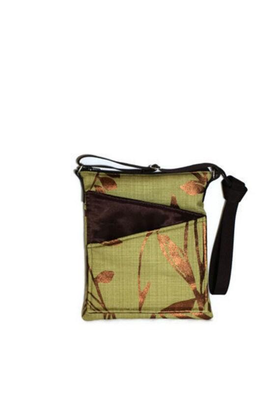 Green fabric travel bag, long strap cross body, front pockets, zip fastening
