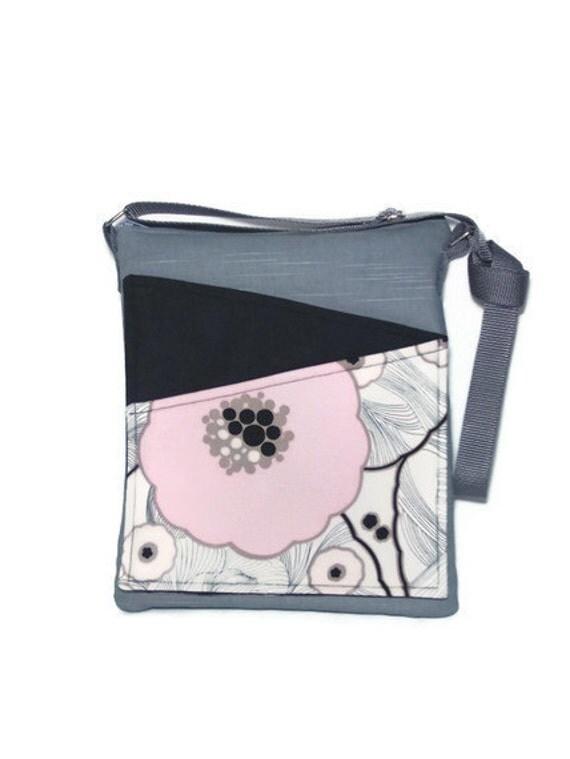 Gray fabric travel bag, long strap cross body, front pockets, zip fastening