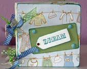 """Baby Boy chipboard album, 5x5"""" in blue, yellow, green with ribbons and photo mats"""