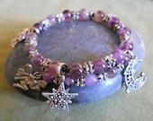 Celestial Charm Bracelet - purple amethyst w mystical pewter charms, moon, star, sun, coil