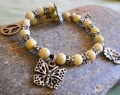 Charm Bracelet - Peace & Love - yellow jasper w hippie pewter charms