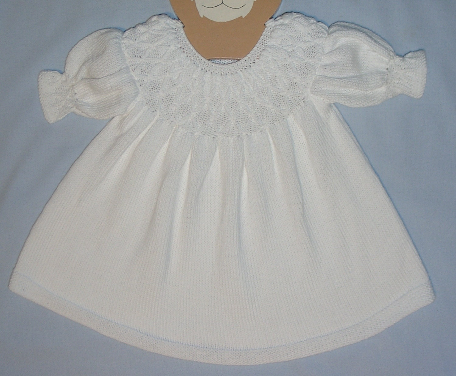 Baby Girl S Hand Knitted And Smocked Dress In White Cotton