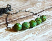 Oxidized sterling silver chain with green caramel apple czech glass