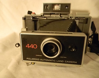 Polaroid 440 land camera with flash and bulbs case