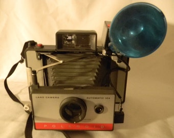 Polaroid 104  land camera with case and extras