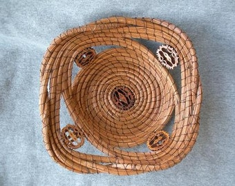 Longleaf pine needle basket with sliced black walnut shells.
